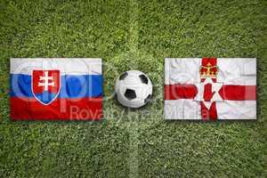 Slovakia vs. Northern Ireland flags on soccer field