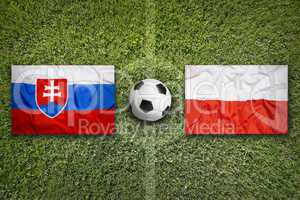 Slovakia vs. Poland flags on soccer field