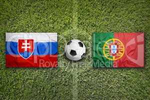 Slovakia vs. Portugal flags on soccer field
