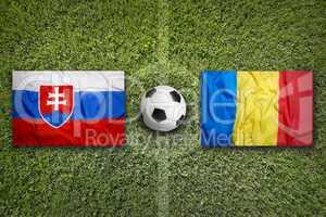 Slovakia vs. Romania flags on soccer field