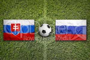 Slovakia vs. Russia flags on soccer field