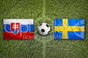 Slovakia vs. Sweden flags on soccer field