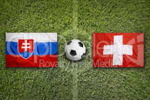Slovakia vs. Switzerland flags on soccer field