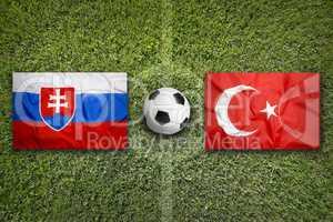 Slovakia vs. Turkey flags on soccer field