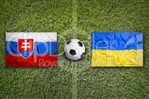 Slovakia vs. Ukraine flags on soccer field