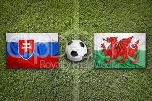 Slovakia vs. Wales flags on soccer field