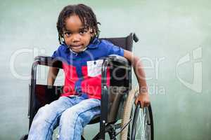 Elementary handicapped boy in classroom