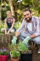 Portrait of happy gardeners planting at garden