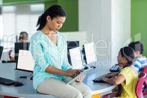Female teacher using digital tablet