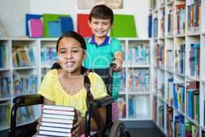 Portrait of handicapped girl with boy at library