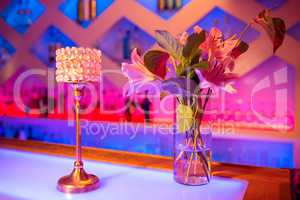 Flower vase and decor on bar counter