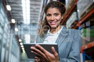Business woman using her tablet