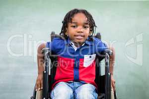 Portrait of handicapped boy in classroom