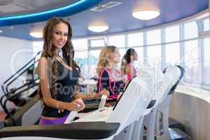 Sexy brunette posing during training on simulator