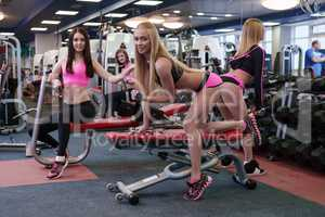 Fitness Centre. Girls exercising with dumbbells