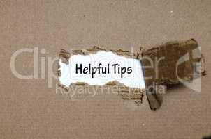 The word helpful tips appearing behind torn paper