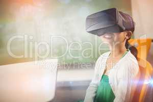 Seated girl wearing virtual reality glasses
