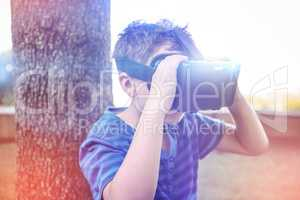Elementary boy looking through virtual reality headset in school