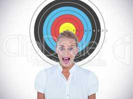 Composite image of portrait of businesswoman in shock