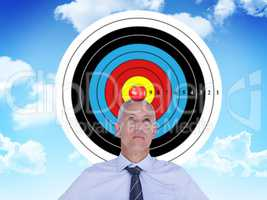 Composite image of businessman thinking