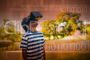 Composite image of blue technology design with binary code