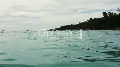 Handheld shot of swimming on the edge of Indian Ocean