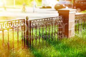 Horizontal park fence border bokeh with light leak background