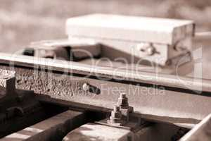Railway maintenance toolkit sepia bokeh background