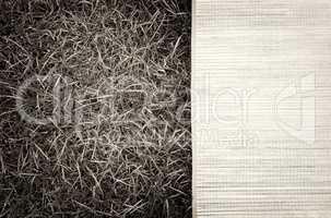Horizontal vintage sepia picnic bamboo bedding on grass backgrou