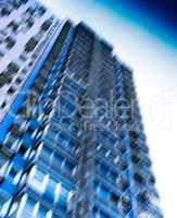 Vertical vivid blue motion blur skyscraper background