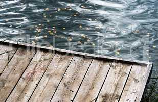 Diagonal autumn wooden river quay background