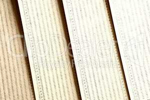 Diagonal vintage yellow punched card textured background