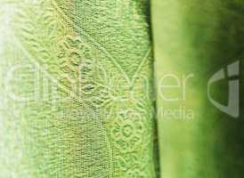 Vertical vivid green fabric bokeh background