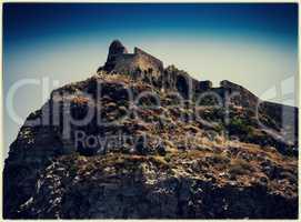 Horizontal vintage abandoned castle on the rock hill landscape p