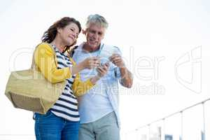 Couple holding map in city