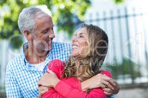 Romantic mature couple standing in city