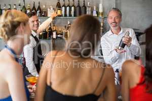 Female friends ordering drinks