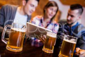Beer mugs with friends at restaurant