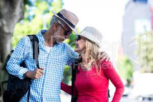 Mature couple looking at each other in city