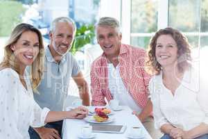 Mature couples having food in restaurant