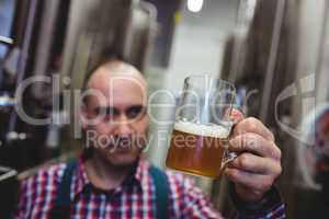 Manufacturer looking at beer mug