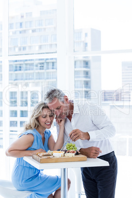 Smart mature couple with food