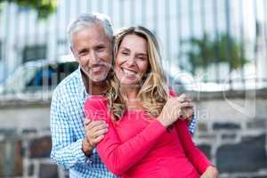 Mature couple standing on city street