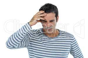 Stressed mid adult man against white background