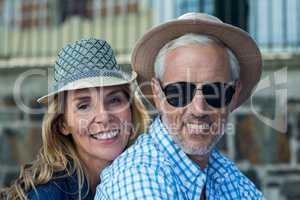 Smiling mature couple in city