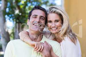 Portrait of romantic couple by building