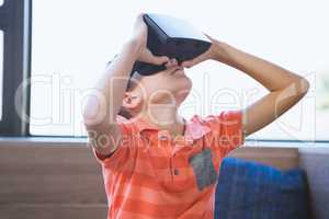 School kid using virtual reality glasses in library