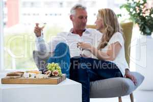 Food on table with mature couple