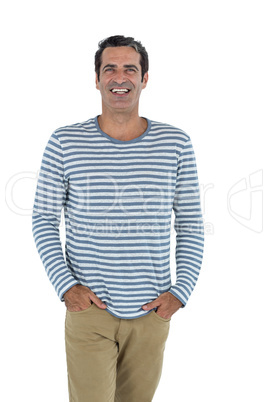 Mid adult man standing against white background