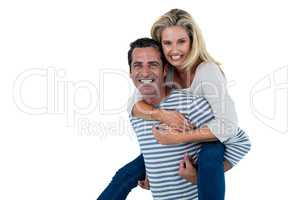 Mid adult man carrying woman piggyback